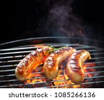 grilled sausages on grill with... | Shutterstock . vector #1085266136