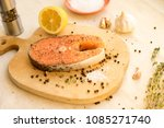 salmon steakes with lemon on... | Shutterstock . vector #1085271740