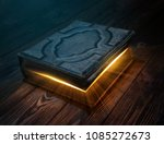 Old Magic Book On Wooden Table...