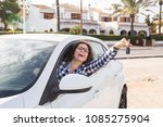 young happy woman test drive... | Shutterstock . vector #1085275904