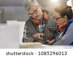 industrial woodwork technicians ... | Shutterstock . vector #1085296013