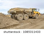 dump trucks at a loamy...