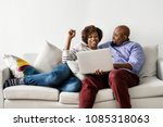 couple using laptop together on ... | Shutterstock . vector #1085318063