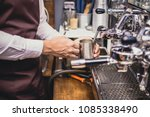 male barista using machine for... | Shutterstock . vector #1085338490