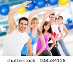 Group of people at the gym in an aerobics class - stock photo