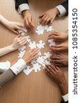 multiracial team assembling... | Shutterstock . vector #1085354150