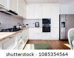 modern kitchen interior with... | Shutterstock . vector #1085354564