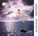 Little Blonde Girl Flying Into the Night Sky - stock photo