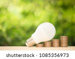 led bulb on the growing coin... | Shutterstock . vector #1085356973