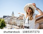young woman tourist pointing on ... | Shutterstock . vector #1085357273