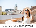 young woman traveler sitting on ... | Shutterstock . vector #1085357309