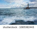 lighhouse and waves on crete ... | Shutterstock . vector #1085382443