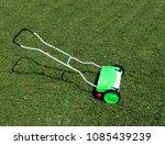 manual lawn mower under the sun ... | Shutterstock . vector #1085439239