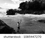fisherman in konprapeng at lao. | Shutterstock . vector #1085447270