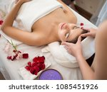 masseur doing massage the head... | Shutterstock . vector #1085451926