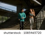 young couple running in urban... | Shutterstock . vector #1085465720