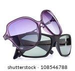 Stylish sunglasses pair isolated on white background cutout - stock photo