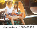 two female skaters best friends ... | Shutterstock . vector #1085475953