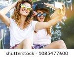 two female skaters friends... | Shutterstock . vector #1085477600
