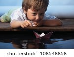 paper ship in children hand | Shutterstock . vector #108548858