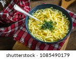 broth   chicken soup with... | Shutterstock . vector #1085490179