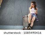 teen female skater sitting on... | Shutterstock . vector #1085490416