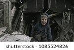 the refugee child cries. war. | Shutterstock . vector #1085524826