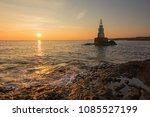 misty sunrise of the lighthouse ... | Shutterstock . vector #1085527199