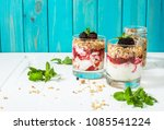 healthy layered dessert with... | Shutterstock . vector #1085541224