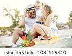 happy family on the beach... | Shutterstock . vector #1085559410