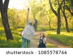 mom and child are strolling... | Shutterstock . vector #1085578766