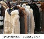 many fur coat for sale at stall ...   Shutterstock . vector #1085594714