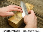 sharpening japanese knife with... | Shutterstock . vector #1085596268