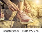 women runner bootlace on her... | Shutterstock . vector #1085597978