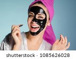 laughing young girl with a... | Shutterstock . vector #1085626028