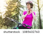 bike helmet. woman putting... | Shutterstock . vector #1085632763