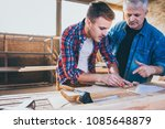 carpenters at work ... | Shutterstock . vector #1085648879
