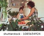 beautiful hispanic mother... | Shutterstock . vector #1085654924