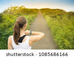 fit female runner looking at... | Shutterstock . vector #1085686166