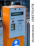 Small photo of automatic machine for payment for parking with bill acceptor and check and time