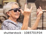 cool old lady  wearing... | Shutterstock . vector #1085701934