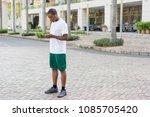 focused black tourist getting...   Shutterstock . vector #1085705420