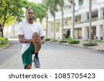 focused black sportsman warming ... | Shutterstock . vector #1085705423