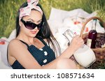 young woman during the picnic... | Shutterstock . vector #108571634
