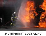 Firefighter Trying To Put Out A ...