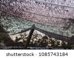 Small photo of Close up black shading net pattern texture and background.Weaved plastic shade/ covers plants and materials to protect and avoid direct sunlight that could harm the object underneath.
