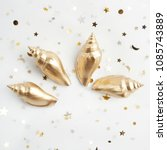 gold shell isolated on white... | Shutterstock . vector #1085743889