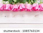 Stock photo pink rose in vase on wood background with copy space 1085763134