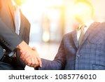 business men shaking hands in... | Shutterstock . vector #1085776010