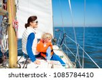 mother and baby boy sail on... | Shutterstock . vector #1085784410